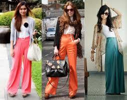 Muheres com pantalonas de cor rosa, laranja e azul