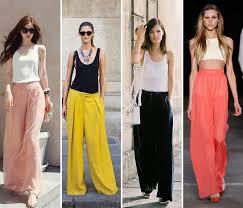 mulheres vestidas com pantalonas rosa amarela e preta