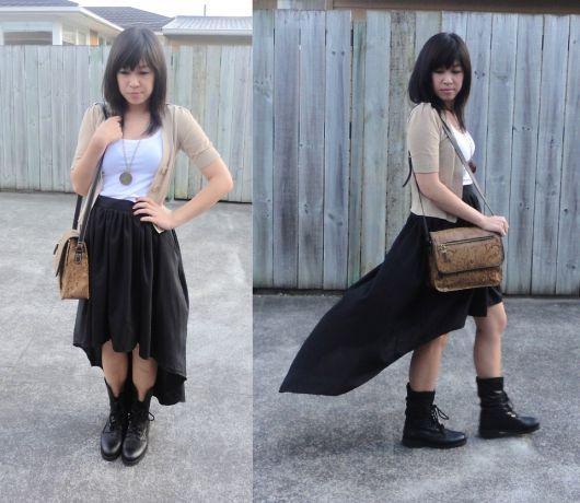 vestir saia assimetrica com botas