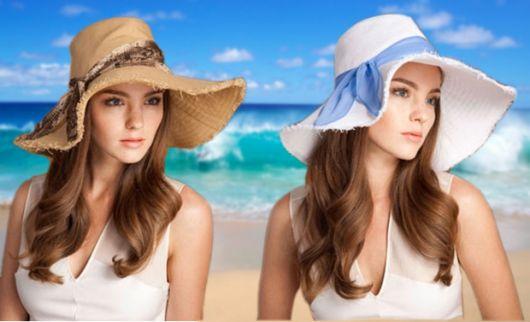 Mulheres curtindo a praia de chapéu floppy.