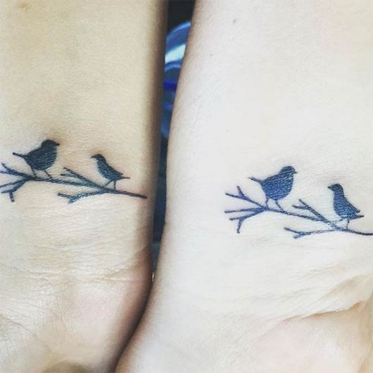 tatuagem mãe e filha passaro