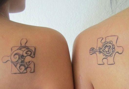 tatuagem mãe e filha qurbra cabeça