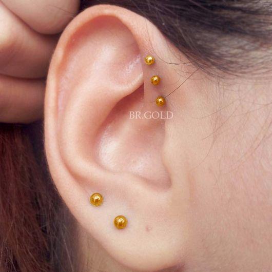 piercing-na-orelha-dourado