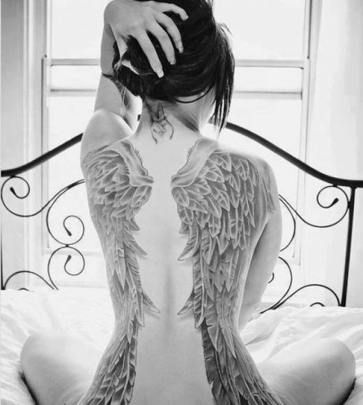 ideia de tatuagem para cobrir estrias para cobrir costas