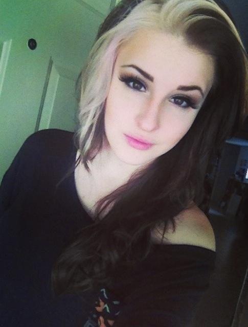 Dark brown hair with one blonde streak