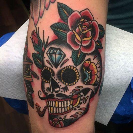 tatuagem de caveira mexicana no braço