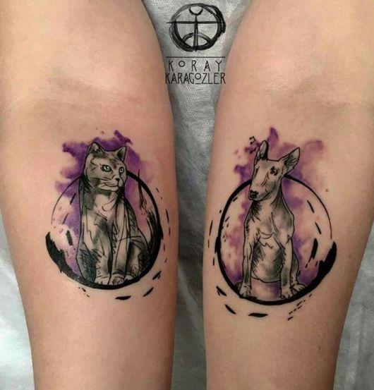 tatuagem de gato com cachorro