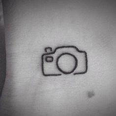 Tatuagem de uma câmera fotográfica