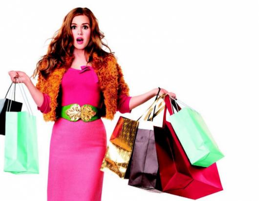 Ilustração de mulher com sacolas de compras, fazendo alusão ao consumismo.