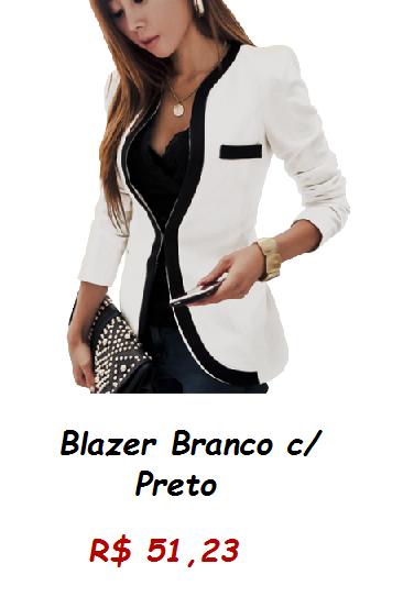 Modelo usa blazer branco com detalhe em preto, blusa preta e carteira de mão.