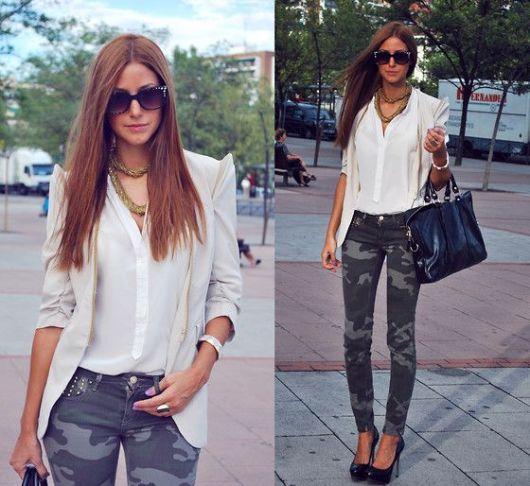 Modelo usa calça camuflada verde, blazer e camisa branca, óculos, bolsa e sapato preto.