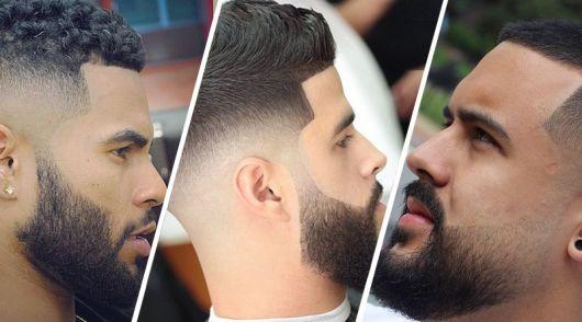 Três homens de perfil um ao lado do outro, todos com cabelo curto e barba degradê