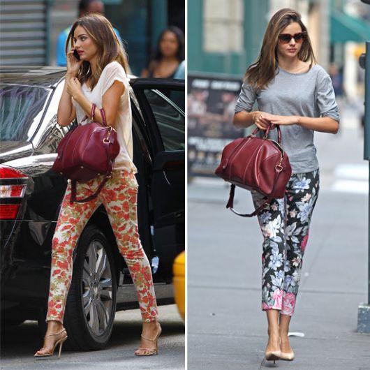 Modelo usa calça floral com blusinha simples lisa nas cores branco e cinza com sapato de salto.