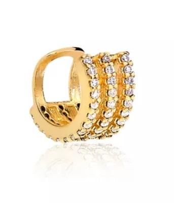 Piercing falso dourado com pedras.