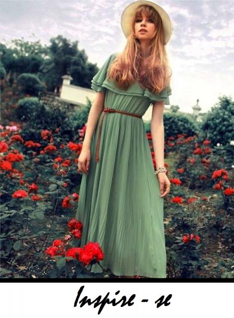 Modelo usa vestido verde longo romantico com chapéu feminino.