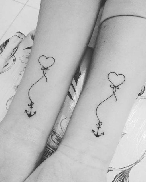 tatuagem coração com âncora