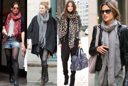 Modelos usam roupas de inverno pesadas com cachecol feminino em cores diversas.