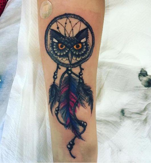 Tatuagem coruja.