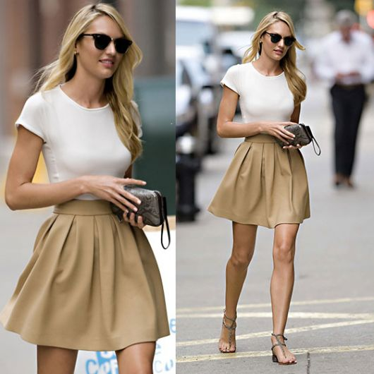 Modelo usa saia cor nude, blusinha branca e sapatilha.