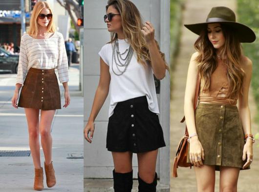 Modelos usam saia de camurça nas cores preto, caramelo e marrom com camiseta branca e botas.
