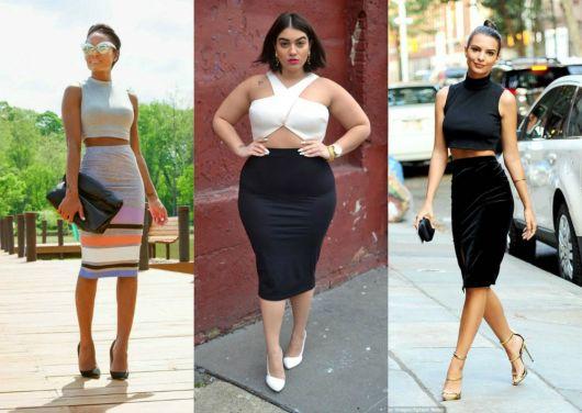 Modelo usa saia justa cintura alta com blusas cropped.