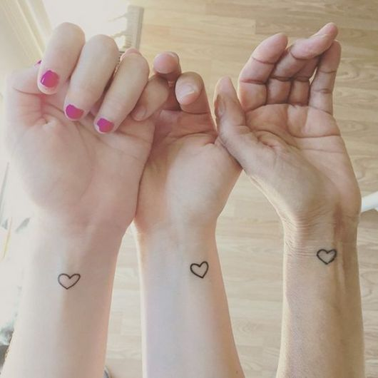tatuagem coração pulso