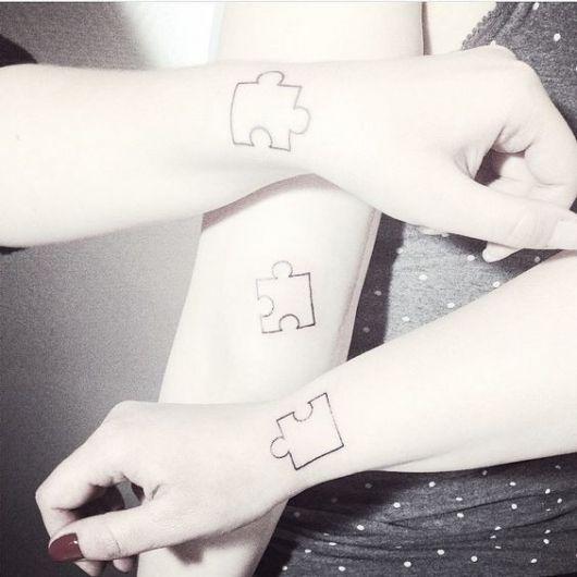tatuagem trio quebra-cabeça