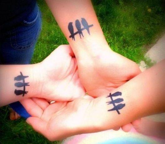 tatuagem pássaros trio
