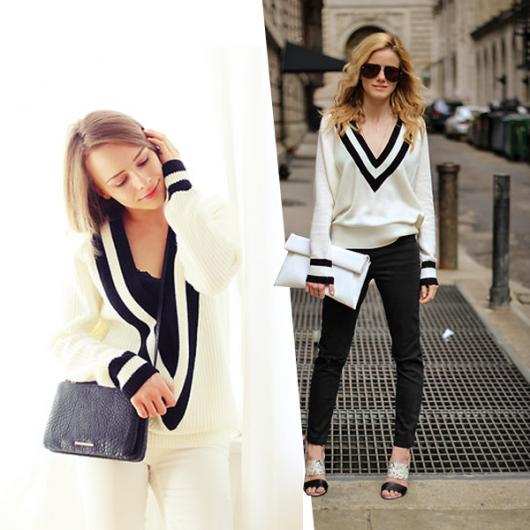 Modelo usa calça preta, sandália preta e blusa branca com listas na gola preta e branca.