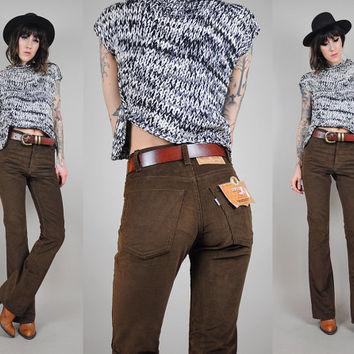 Calça boot cut cintura alta.