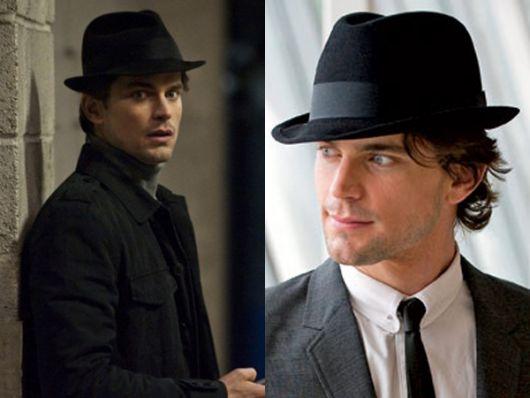 Modelo usa chapéu fedora preto com terno.