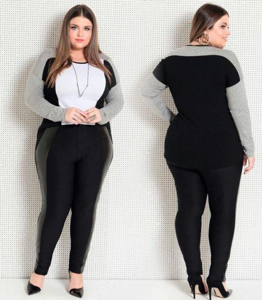 Modelo veste calça preta, sacarpin preto e blusa manga longa preta com branco e cinza.