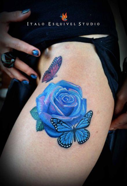 tatuagem flor com borboletas
