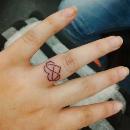 tatuagem de coração com símbolo do infinito