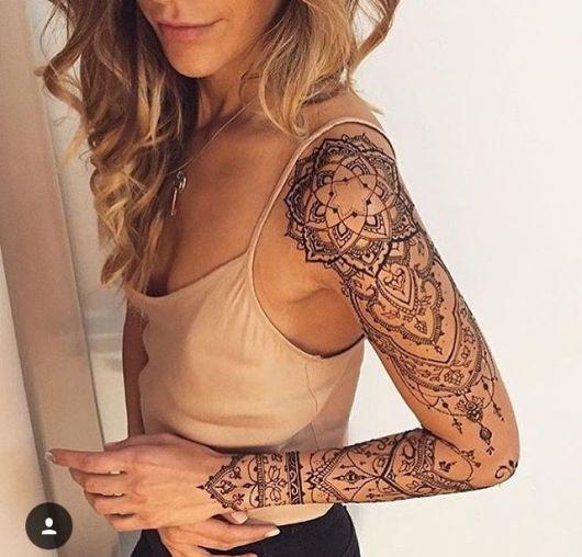 tatuagem braço fechado feminino mandala