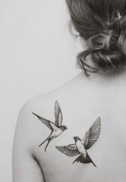 tatuagem casal de pássaros