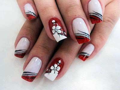 unhas vermelhas com branco decoradas.