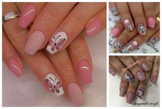 Unhas decoradas com borboletas rosas.