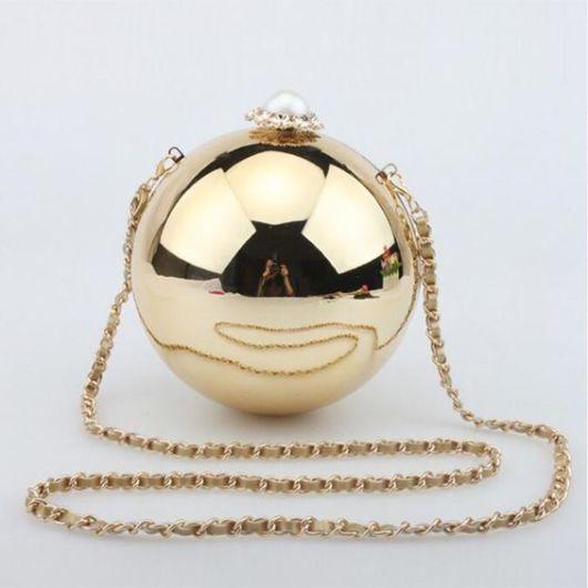 bolsa bola dourada