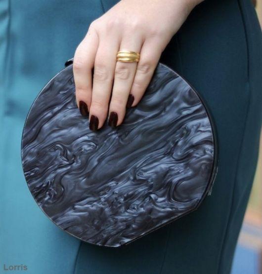 clutch redonda de mão