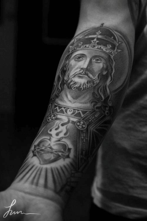 Tatuagem realista braço