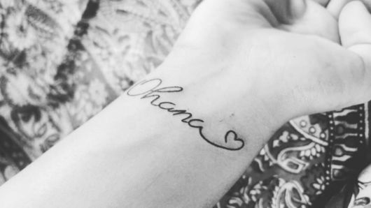tatuagem escrita com coração