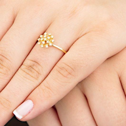 anel ouro chuveiro