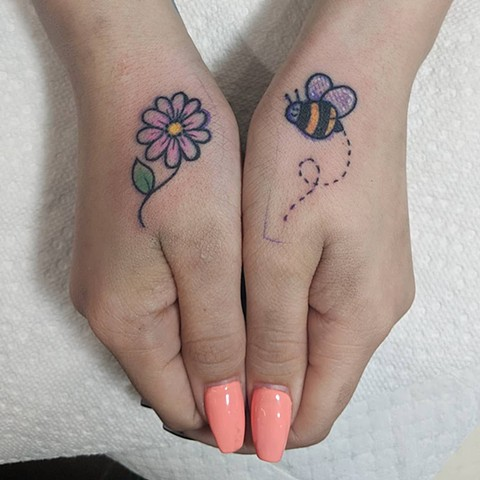 tatuagem flor simples