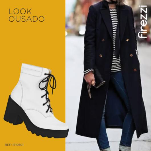 modelo veste jaqueta preta, bota branca e calça jeans.