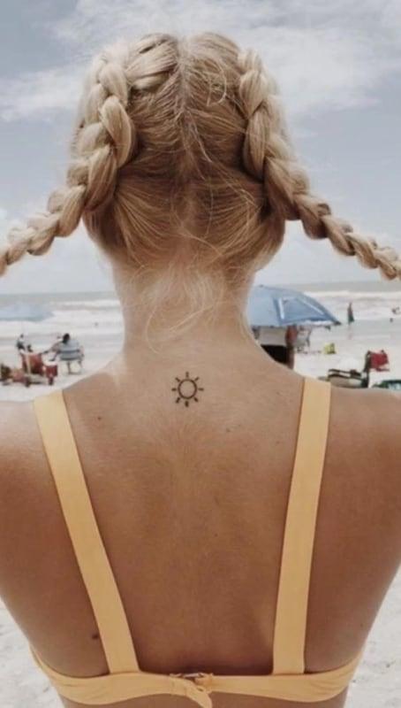tatuagem de sol nas costas