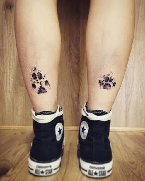 inspiração de tatuagem de pata de cachorro pequena e delicada