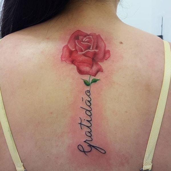 tatuagem gratidão nas costas grande