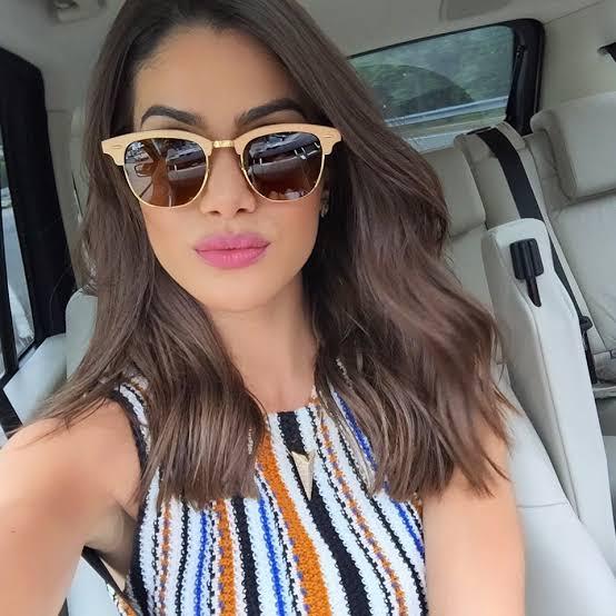 óculos de madeira feminino escuros