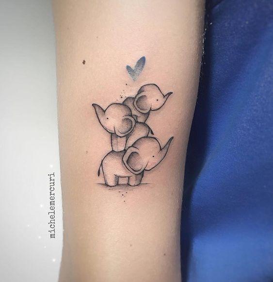 tatuagem de elefantes no braço